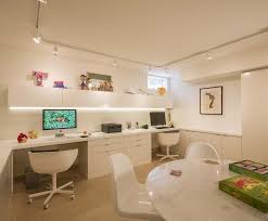 lighting for study room. study room for children featuring track lighting over an expanse of white desks and shelving t