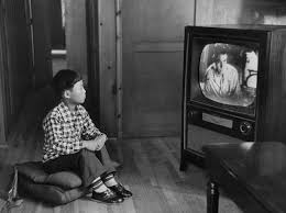 family watching tv 1950s. an adopted korean war orphan, kang koo ri, watches television in his new home los angeles 1956 family watching tv 1950s