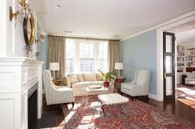 great transitional living room pale green curtains blue walls red