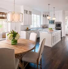 by pairing white cabinets and white perimeter countertops with an all wood island the designer amped up the warmth even more
