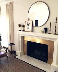 living room decor above fireplace