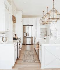 white kitchen with champagne bronze fixtures and brass lighting ...