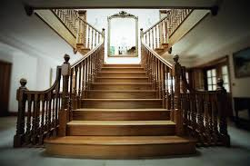 Cut string staircase with dark mahogany treads and handrail.