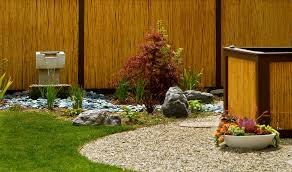 a bamboo screen is a perfect backdrop for your garden adding a water feature like