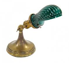 portable electric lamp featuring a uniquely shaped fluted green cased glass shade