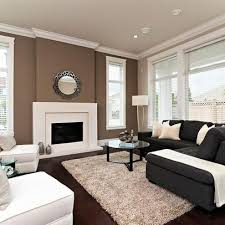 Brown accent Wall with tan walls. This is what I plan to do to my living  room walls, only my accent wall will be a deeper darker brown Brown accent