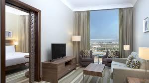 garden inn hotel. A Junior Suite At Hilton Garden Inn Dubai Al Muraqabat In Deira, Courtesy Hotel