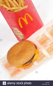 mcdonalds double cheeseburger and fries. Delighful Mcdonalds McDonalds Double Cheeseburger On Paper Wrapper With Large French Fries  White Background USA  Stock In Mcdonalds Double Cheeseburger And Fries 8