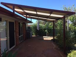 raised flat patio with fly over by great aussie patios