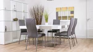 8 seater white floating dining table and real leather dining chairs