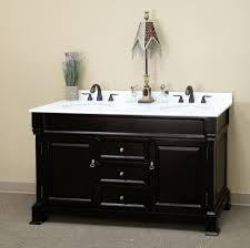 Black Polished Iron Double Tap Faucet Above White Ceramic