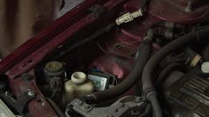 auto repair replacing power steering fluid