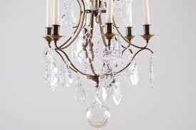rococo style six light chandelier with cut glass and crystal leaf shaped prisms northern europe c 1880