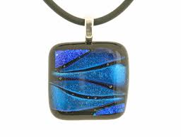 dichroic glass pendant on black rubber cord