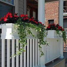 Love this look....flower boxes that can be attached to railings,