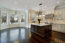 kitchen black high gloss wood countertops dark floors with white cabinets grey metal faucet sprayer