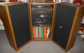 sound system cabinets. item # 11 -- technics complete stereo system in wood cabinet w/ glass front doors, pr floor speakers, synthesizer, amplifier, cd player, turntable, sound cabinets