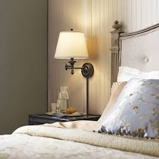 bedroom wall lighting ideas. conserve valuable bedside table space by installing a chic and convenient swingarm wall lamp bedroom lighting ideas