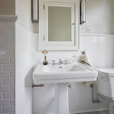 pedestal sink on marble maze floor tiles