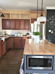 custom cabinets matching existing adding