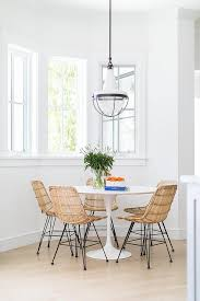 round saarinen dining table with modern wicker dining chairs view full size
