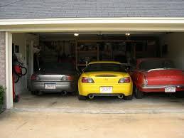 3 cars crammed in garage