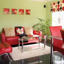 Bold modern living room with blue sofa and red armchair