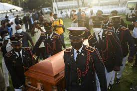 Family gathered for the funeral of ...
