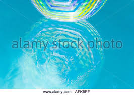 pool water with beach ball. Beach Ball Reflection In Swimming Pool Water - Stock Photo With O