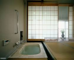 sunken bathtub filled with water in traditionally japanese removal bathroom stock photo full size