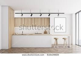 wooden furniture for kitchen. Front View Of A White Kitchen With Bar And Light Wooden Furniture There Is For