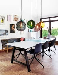 view in gallery colorful orbs above the dining table breathe life into the curated contemporary dining room