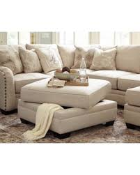 ashley furniture enola sectional.  Enola Ashley Furniture Luxora Bisque Finish Fabric Upholstered Ottoman With  Storage In Enola Sectional C