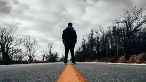 lonely man standing at the middle of a road hd wallpaper