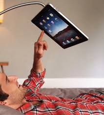 Use the iPad hands free...would be great for watching movies in bed