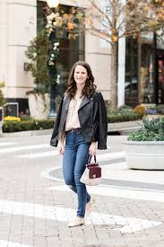 how to look feminine chic in a leather jacket winter style midtown magnolia