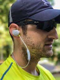 bose sport earphones wireless. michael wearing the bose soundsport wireless headphones sport earphones