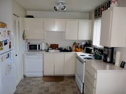 fascinating kitchens with white cabinets. Kitchen. White Wooden Kitchen Cabinet Placed On The Wall Also Cream Brown Tile Floor Fascinating Kitchens With Cabinets R