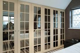 fitted wardrobe with mirrored doors