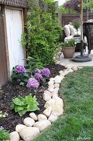 river rock planter border rock garden