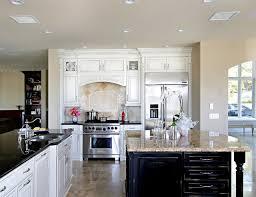 white cabinets with dark island in coto de caza contemporary kitchen