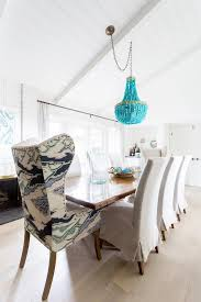 turquoise beaded chandelier on sloped ceiling