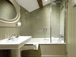 bathroom with olive green tiles