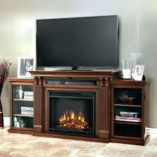 corner fireplace glass doors electric fireplace media center the entertainment mantel features ample storage with its