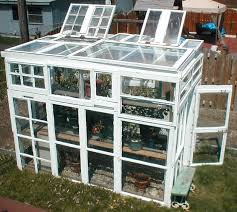 the upcycled old windows greenhouse