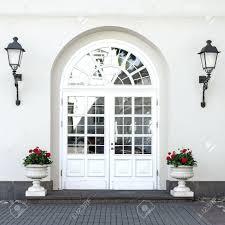 elegant double front doors. Elegant Classic Style Double Glass Paned Front Door With Lanterns And Flower Pots Stock Photo Doors Wreaths