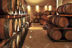 oak wine barrels. stacked oak wine barrels in winery cellar stock photo 4616873 n