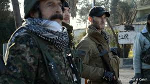 Image result for Richard Jones (right), stands with YPG official (left) near Syria/Turkish border in Ras al Ayn, Syria PHOTO