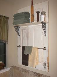 turn an old door into a bathroom shelf towel rack picture for 20 simple and creative ideas of how to reuse old doors