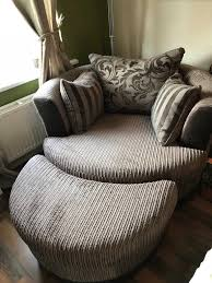 dfs infinity swivel chair and half moon footstool mocha colour